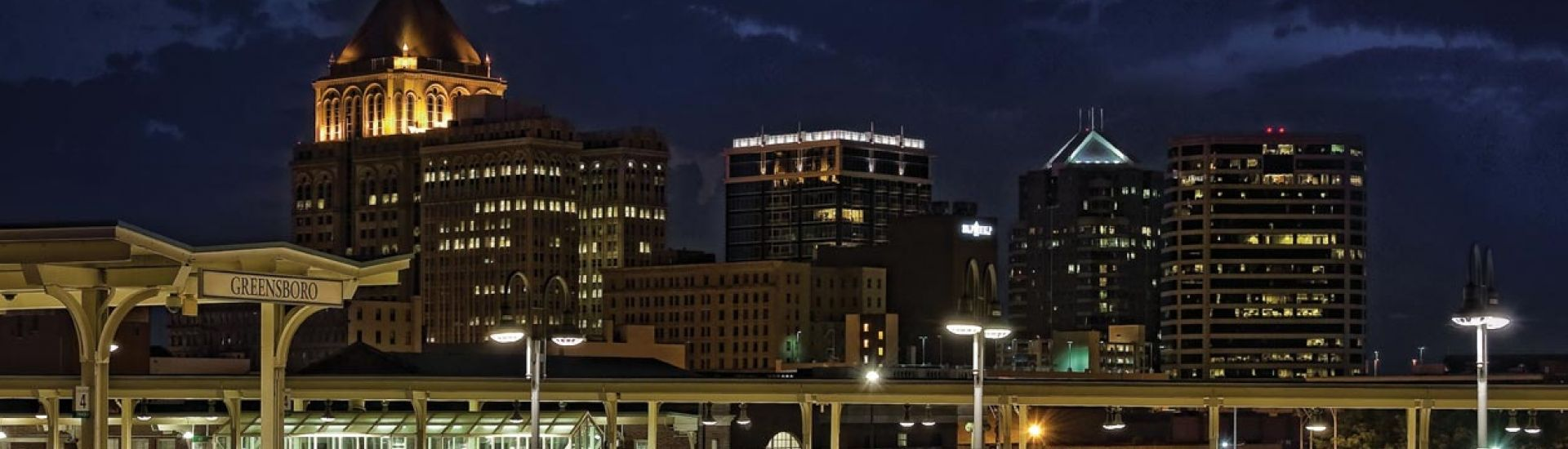 Greensboro-night-skyline-with-moon-by-dan-routh-photography 1