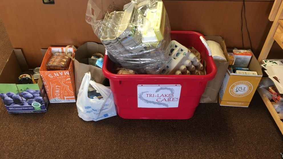 150 pounds of donations to Tri-Lakes Cares