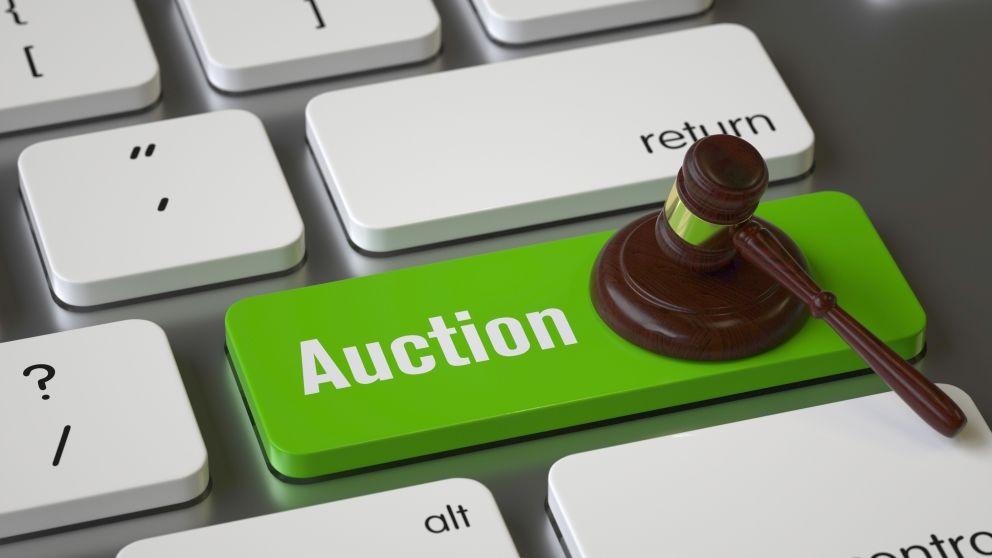 Green auction button  gavel